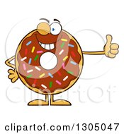 Clipart Of A Cartoon Winking Round Chocolate Sprinkled Donut Character Giving A Thumb Up Royalty Free Vector Illustration by Hit Toon