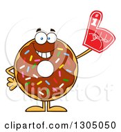 Clipart Of A Cartoon Happy Round Chocolate Sprinkled Donut Character Wearing A Foam Finger Royalty Free Vector Illustration by Hit Toon