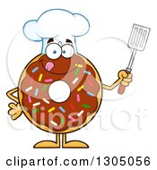 Clipart Of A Cartoon Happy Round Chocolate Sprinkled Donut Chef Character Holding A Spatula Royalty Free Vector Illustration by Hit Toon