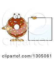 Clipart Of A Cartoon Happy Round Chocolate Sprinkled Donut Character Pointing To A Blank Sign Royalty Free Vector Illustration by Hit Toon