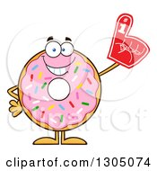 Clipart Of A Cartoon Happy Round Pink Sprinkled Donut Character Wearing A Foam Finger Royalty Free Vector Illustration by Hit Toon
