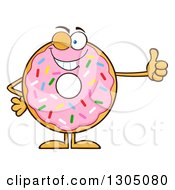 Clipart Of A Cartoon Winking Round Pink Sprinkled Donut Character Giving A Thumb Up Royalty Free Vector Illustration by Hit Toon
