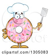 Clipart Of A Cartoon Happy Round Pink Sprinkled Donut Chef Character Holding A Spatula Royalty Free Vector Illustration by Hit Toon