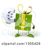 Clipart Of A 3d Happy Green Gift Character Holding A Euro Symbol Royalty Free Illustration