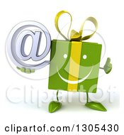 Clipart Of A 3d Happy Green Gift Character Holding An Email Arobase At Symbol And Thumb Up Royalty Free Illustration