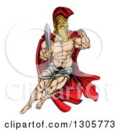 Clipart Of A Muscular Gladiator Man In A Helmet Fighting With A Sword And Holding Up A Fist Royalty Free Vector Illustration