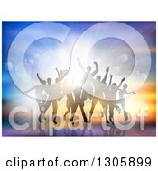Clipart Of A Crowd Of Silhouetted Male And Female Dancers Moving And Jumping Against Flares And A Burst Of Light Royalty Free Vector Illustration