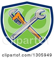 Clipart Of Cartoon Crossed Spanner And Monkey Wrenches In A Blue White And Green Shield Royalty Free Vector Illustration