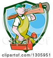 Clipart Of A Cartoon White Male Plumber Walking With A Tool Box And Giant Monkey Wrench On His Shoulder And Emerging From A Green White And Blue Shield Royalty Free Vector Illustration
