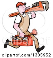 Cartoon White Male Plumber Walking With A Tool Box And Giant Monkey Wrench On His Shoulder