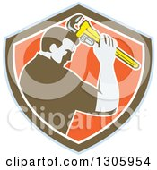 Clipart Of A Retro Male Plumber Bowing And Holding A Monkey Wrench To His Head In A Blue Brown White And Orange Shield Royalty Free Vector Illustration