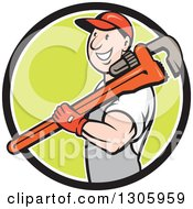 Cartoon Happy White Male Plumber Holding A Giant Monkey Wrench Over His Shoulder And Emerging From A Black White And Green Circle