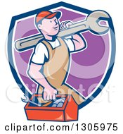 Clipart Of A Retro Cartoon Happy White Male Mechanic Carrying A Tool Box And Giant Wrench And Emerging From A Blue White And Purple Shield Royalty Free Vector Illustration
