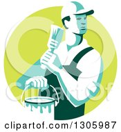 Poster, Art Print Of Retro Male House Painter Holding A Brush And Bucket Looking Back In A Green Circle
