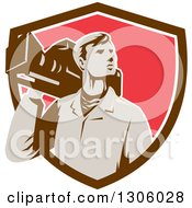 Clipart Of A Retro Male Cameraman Looking To The Side And Emerging From A Brown White And Red Shield Royalty Free Vector Illustration