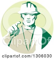 Clipart Of A Retro Male Construction Worker Builder Pointing Outwards In A Pastel Green Circle Royalty Free Vector Illustration