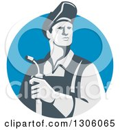 Clipart Of A Retro Male Welder Holding A Torch In A Blue Shield Royalty Free Vector Illustration