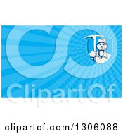 Clipart Of A Retro Male Coal Miner Holding A Pickaxe And Blue Rays Background Or Business Card Design Royalty Free Illustration