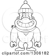 Lineart Clipart Of A Cartoon Black And White Happy Yeti Abominable Snowman Monkey Wearing A Winter Hat And Scarf Royalty Free Outline Vector Illustration