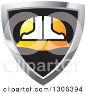 Clipart Of A Black White And Gradient Orange Hardhat Helmet In A Shield Royalty Free Vector Illustration by Lal Perera