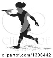 Black Silhouetted Girl Running And Playing With A Paper Plane
