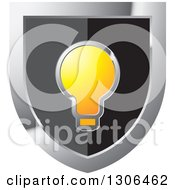 Clipart Of A Black And Silver Shield With A Light Bulb Royalty Free Vector Illustration