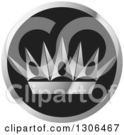 Clipart Of A Silver Crown In A Black And Gray Circle Royalty Free Vector Illustration by Lal Perera