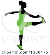 Clipart Of A Black Silhouetted Woman In Green Stretching And Reaching For Her Toes Royalty Free Vector Illustration