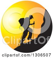 Clipart Of A Black Silhouetted Man Hiking A Mountain Against A Sunset Circle Royalty Free Vector Illustration
