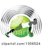 Clipart Of A Black Silhouetted Woman In Green And White Exercising With A Ball Over A Circle And Silver Arches Royalty Free Vector Illustration by Lal Perera