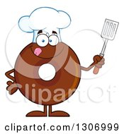 Clipart Of A Cartoon Happy Round Chocolate Donut Chef Character Holding A Spatula Royalty Free Vector Illustration by Hit Toon