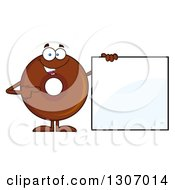 Clipart Of A Cartoon Happy Round Chocolate Donut Character Holding And Pointing To A Blank Sign Royalty Free Vector Illustration by Hit Toon