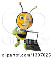 Clipart Of A 3d Happy Gardener Bee Holding Up And Pointing At A Laptop Computer With A Blank Screen Royalty Free Illustration