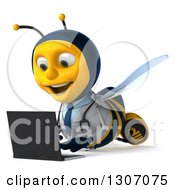 Clipart Of A 3d Happy Bee Doctor Using A Laptop On The Floor Royalty Free Illustration