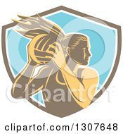 Clipart Of A Retro Woodcut Female Volleyball Player Rebounding In A Brown White And Blue Shield Royalty Free Vector Illustration