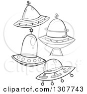 Clipart Of Black And White Flying Saucers Royalty Free Vector Illustration by BNP Design Studio