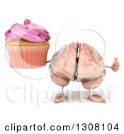 Clipart Of A 3d Brain Character Holding A Pink Frosted Cupcake And Thumb Up Royalty Free Illustration