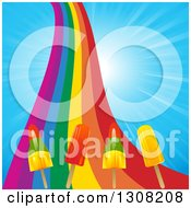 Clipart Of A Rainbow With Popsicles Over A Blue Sunny Sky Royalty Free Vector Illustration by elaineitalia