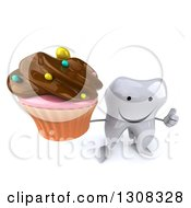Clipart Of A 3d Happy Tooth Character Holding Up A Thumb And Chocolate Frosted Cupcake Royalty Free Illustration
