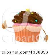 Clipart Of A 3d Chocolate Frosted Cupcake Character Giving A Thumb Up Royalty Free Illustration by Julos
