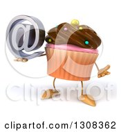 Clipart Of A 3d Chocolate Frosted Cupcake Character Shrugging And Holding An Email Arobase At Symbol Royalty Free Illustration