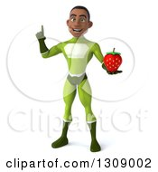 Clipart Of A 3d Young Black Male Super Hero In A Green Suit Holding Up A Finger And A Strawberry Royalty Free Illustration