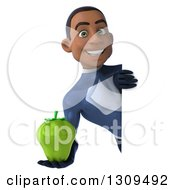 Clipart Of A 3d Young Black Male Super Hero Dark Blue Suit Holding A Green Bell Pepper Around A Sign Royalty Free Illustration