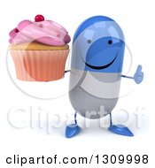 Clipart Of A 3d Happy Blue And White Pill Character Holding Up A Thumb And A Pink Frosted Cupcake Royalty Free Illustration