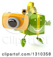 Clipart Of A 3d Happy Green Gift Character Facing Slightly Right Jumping And Holding A Camera Royalty Free Illustration
