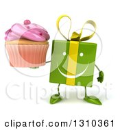 Clipart Of A 3d Happy Green Gift Character Holding A Pink Frosted Cupcake Royalty Free Illustration