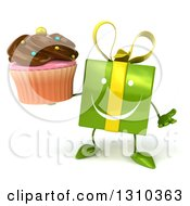 Clipart Of A 3d Happy Green Gift Character Shrugging And Holding A Chocolate Frosted Cupcake Royalty Free Illustration