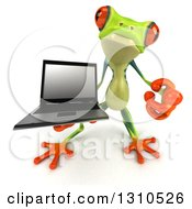 3d Argie Frog Holding Up A Laptop Computer And Pointing Outwards