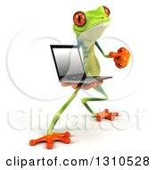 Clipart Of A 3d Argie Frog Facing Slightly Right Holding And Pointing To A Laptop Computer Royalty Free Illustration