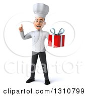 Clipart Of A 3d Young White Male Chef Holding Up A Finger And A Gift Royalty Free Illustration